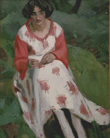 Noémie brodant en robe blanche et rouge