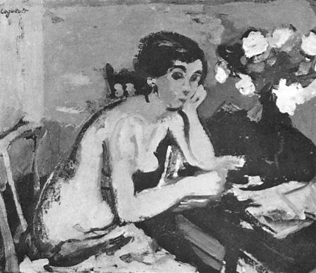Femme assise dans une chambre rose